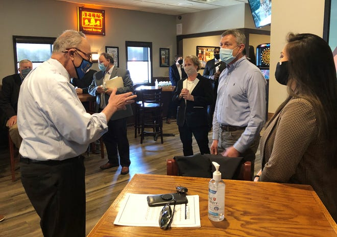 Senate Majority Leader Charles Schumer, D-New York, talks Monday with members of the restaurant industry and Victor officials during a visit to the Thirsty Turtle Bar & Grill.