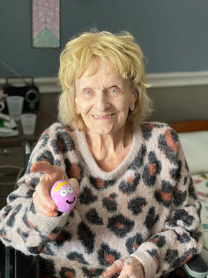 Ontario Center resident Anna Bertucci, 97, of Rochester, decorates her Easter eggs with a face at the Canandaigua rehabilitation center.