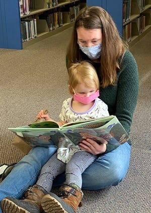 Holly Larkin reads with daughter Althea Larkin during Storytime April 2 at the Earlville Free Library. All children who haven't started school are invited to join the next Storytime at 10 a.m. April 9.
