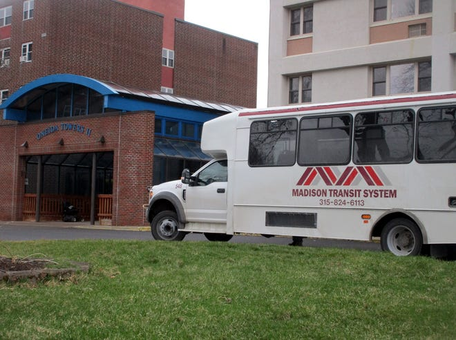 A Madison Transit System bus arrives March 31 at the Towers apartment complex in Oneida. Hamilton and Madison Democrats and the Hamilton Public Library are raising funds to provide bus tokens for select riders using the public transportation system.