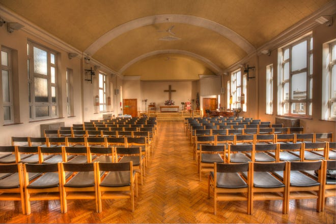 Empty chairs in a church.