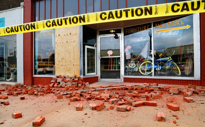 In this 2016 photo, bricks litter the sidewalk in front of a downtown store in Cushing after a magnitude 5.0 earthquake.