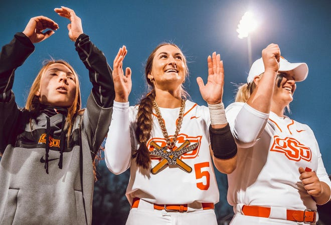 Oklahoma State's Kiley Naomi (5) celebrates after hitting a game-winning home run last Thursday against Iowa State.