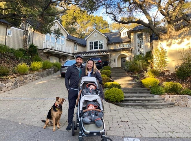 Kristina and Grayson Dove, with their 9-month-old twins, Bodhi and Phoenix, and dog Monte are shown outside their new home in the San Francisco suburbs.