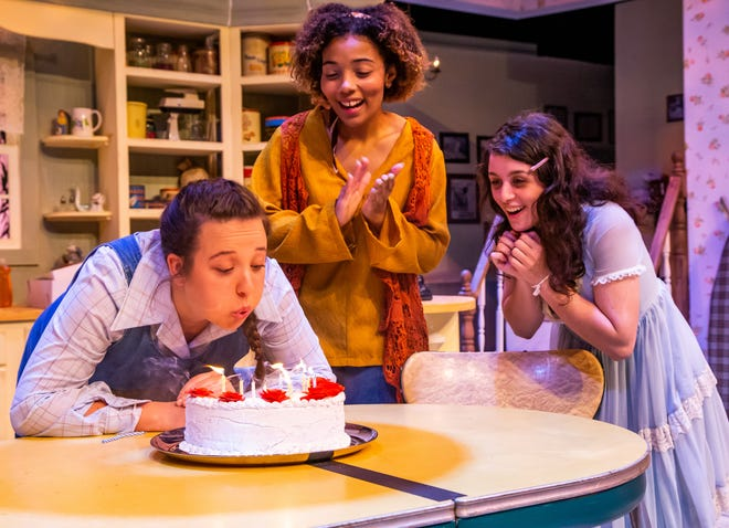"""Kiersten Nicole Farley, playing the part of Lenny MaGrath, left, blows the candles out on her cake as Lizzy Allen, playing the part of Meg MaGrath, center and Lily Capote, playing the part of Babe Botrelle, cheer Lenny on. The cast of the latest Ocala Civic Theatre production, """"Crimes of the Heart,"""" held a dress rehearsal Monday night. The show runs April 8 through May 2."""