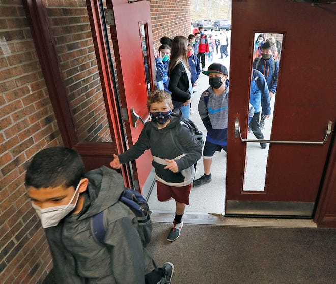 Students at the Archie Morrison School in Braintree get a warm welcome back to all day classes, all week by teachers and staff  on Monday April 5, 2021 Greg Derr/The Patriot Ledger