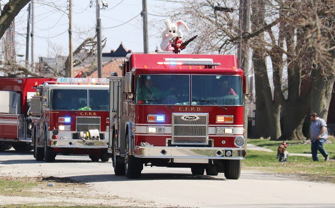 The Easter Bunny rides through the streets of Chenoa waving to residents and throwing candy for children as part of the Easter weekend in Chenoa.