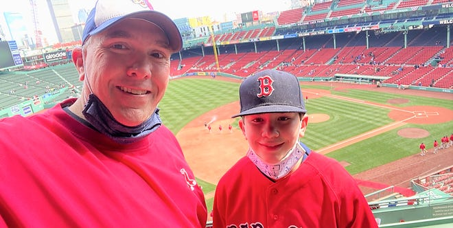 Seacoast Media Group sports editor Jay Pinsonnault and his youngest son, Bryce, were two of the 4,500 fans allowed into Fenway Park last Friday on Opening Day. The Red Sox lost to Baltimore, 3-0.