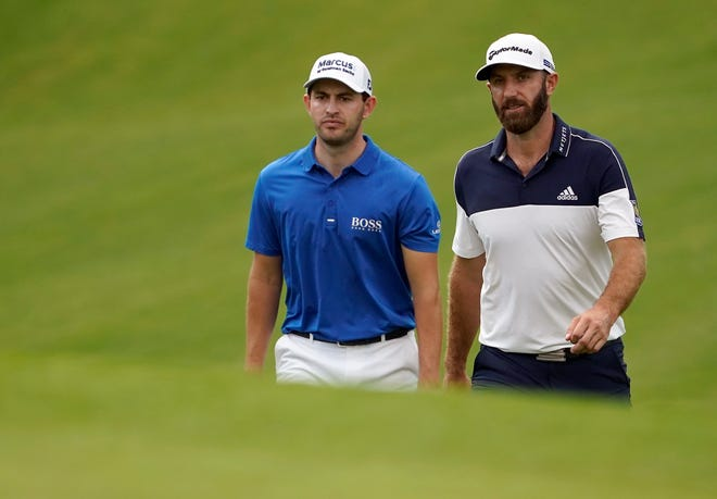 Patrick Cantlay and Dustin Johnson walk up the seventh fairway during the first round of the 2020 Masters at Augusta National GC. [Michael Madrid-USA TODAY Sports]