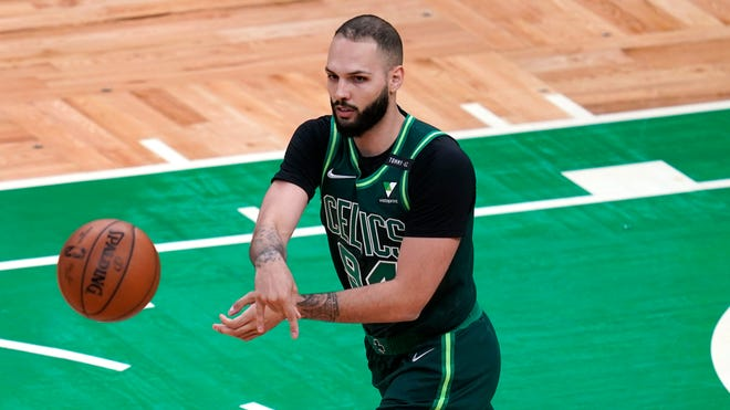 Celtics guard Evan Fournier passes the ball during a game last week in Boston.