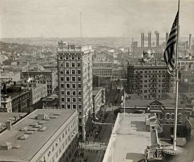 A 1921 panoramic view of downtown Providence from atop the Biltmore Hotel (now The Graduate), looking south toward the Providence River. The top of Providence City Hall is at bottom right, with the flag pole. The taller building at middle right is the Narragansett Hotel, demolished in 1960 and now the site of Johnson & Wales University. The smoke stacks of Narragansett Electric can be seen in the distance.
