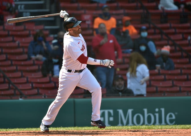 Apr 4, 2021; Boston, Massachusetts, USA;  Boston Red Sox designated hitter J.D. Martinez (28) hits a home run during the fourth inning against the Baltimore Orioles at Fenway Park. Mandatory Credit: Bob DeChiara-USA TODAY Sports