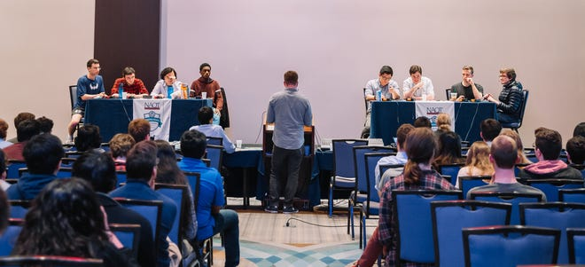 Typically in the national Intercollegiate Championship Tournament, commonly called quiz bowl, teams face off in person, like here in 2019. Because of the pandemic, the 2021 tournament will be virtual.