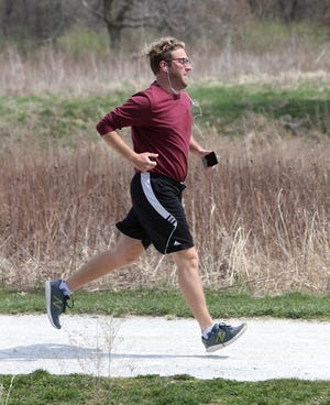 A runner makes his way through Veterans Park in Plain Township on April 5. Plain is asking voters to approve a 1-mill parks levy.