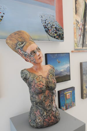 """A ceramic piece """"Masquerade"""" by Linda Ganstrom, ceramics professor at Fort Hays State University, is one of the pieces on display and for sale at the new Salon 50 exhibit at the Salina Art Center, 242 S. Santa Fe Ave."""