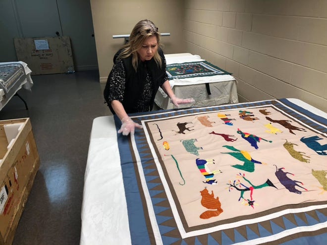"""The Cross Timbers Fine Arts Council recently installed its latest exhibit """"Cloth as Community: Hmong Textiles in America."""" This national exhibition will open to the public at no charge, April 6 through May 25 at the River North Gallery."""