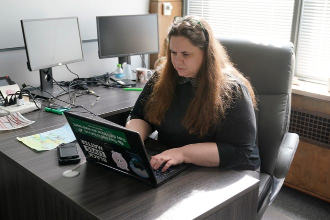 The Michigan Coalition to End Domestic and Sexual Violence Executive Director Sarah Prout Rennie is photographed March 31, 2021 in Detroit. Michigan is facing another public health threat on top of COVID-19: soaring domestic violence cases says Prout Rennie. (AP Photo/Carlos Osorio)