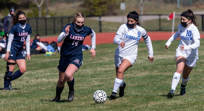 Apponequet's Devin Sylvia leads the charge downfield with Fairhaven's Mia Almeida and Ariana Ribeiro looking to defend Saturday in South Coast Conference soccer action in Lakeville. Apponequet picked up its first win of the season, 3-1.