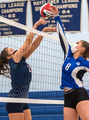 Apponequet's Abi Lens and Fairhaven's Ava Fernandes face of at the net Friday night during a South Coast Conference contest that went down to the wire, with Apponequet taking a 3-2 final for the win.