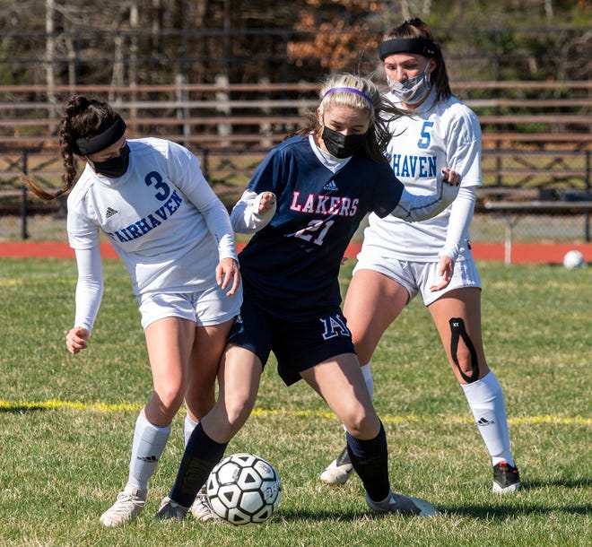 Apponequet's Jaida Beaulieu battles with Fairhaven's Sadie Hubert, as Abygale Lundstrom looks on.