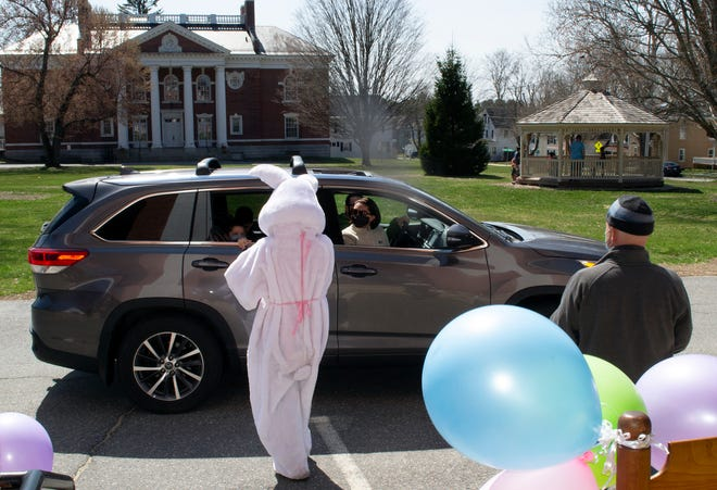 The Easter Bunny greeted families during a drive-by event in front of the First Church of Christ Unitarian in Lancaster on Easter.