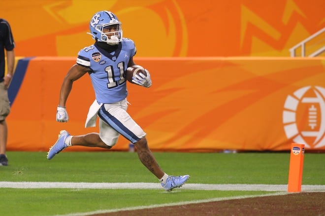 North Carolina Tar Heels wide receiver Josh Downs (11) runs with the football for a touchdown against the Texas A&M Aggies in the fourth quarter of the game at Hard Rock Stadium on Jan 2, 2021, in Miami Gardens, Fla.