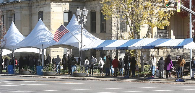 An overhead covering was set up in case of rain as folks lined up for the last day of early voting at the Tuscarawas County Courthouse in November.