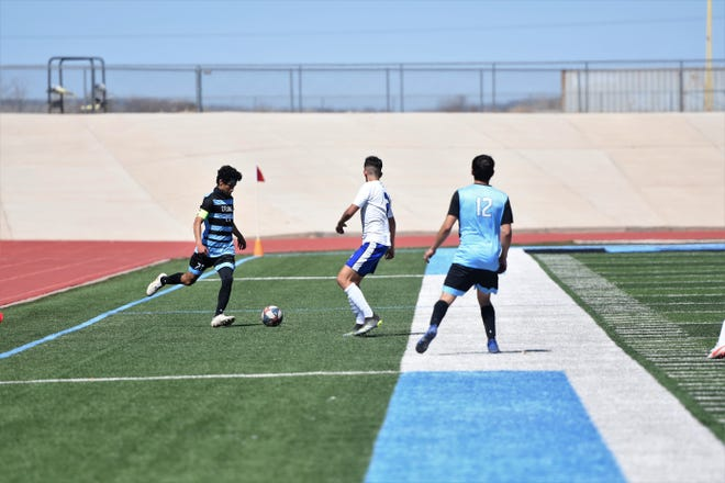 Pueblo West's Donovan Esquibel passes the ball in a game against Pueblo Central Saturday afternoon.