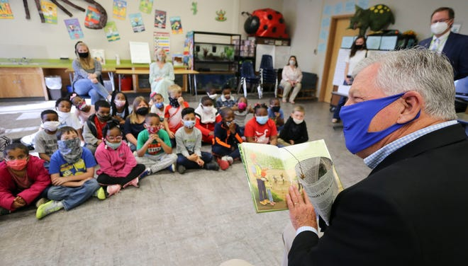 """State Sen. Gerald Allen reads a book about loggers and forestry to first-graders at Woodland Forrest Elementary in Tuscaloosa on Monday, April 5, 2021. The book, """"Lucy Meets A Logger,"""" was written by Stephanie Fuller whose father was a logger. It is an effort by the Alabama Forestry Association to reach students at an early age. [Staff Photo/Gary Cosby Jr.]"""