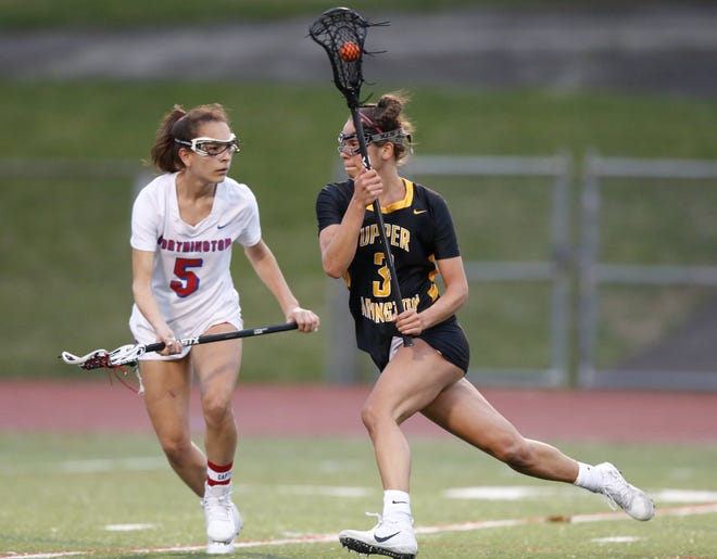 Upper Arlington's Annie Hargraves works against Thomas Worthington's Bella Avila during a game March 25 at Thomas. Hargraves, a senior midfielder and Ohio State recruit, suffered a torn ACL and meniscus during practice March 29 and will miss the rest of the season.