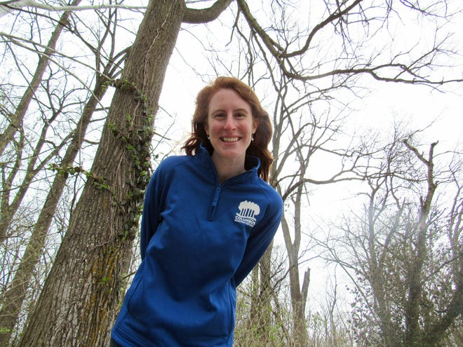 Rosalie Hendon, environmental planner for the Columbus Recreation and Parks Department, stands amid large shade trees in Antrim Park in northwest Columbus. The recently released urban-forestry master plan, of which Hendon is project manager, calls for increasing the tree canopy throughout the city.