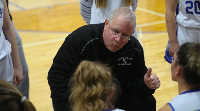 Ready girls basketball coach Joe Lang instructs his team during a game in December 2019. Lang told his team April 6 that he was retiring after 40 seasons leading the Silver Knights.
