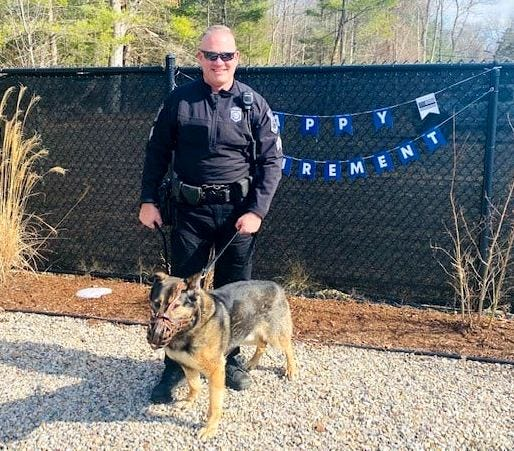 Sgt. Brian McLaughlin with his K-9 partner, Tango, who will continue to live with McLaughlin and his family at their home.