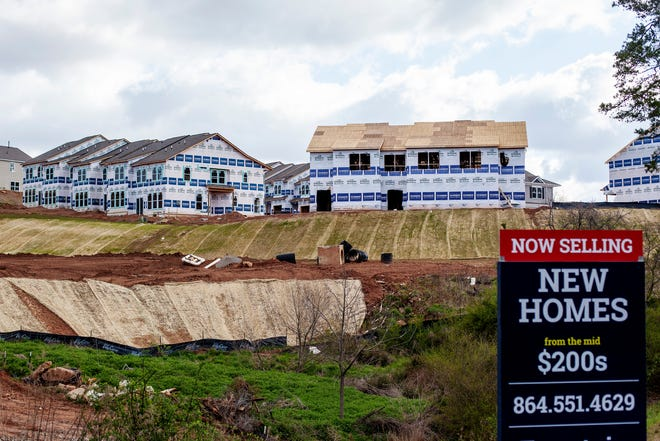 Homes under construction in Asheville April 1, 2021. Recent studies show a gap of thousands of housing units as the Asheville area chips away at providing affordable housing in an area where one of five homeowners and almost 46% of renters are deemed cost-burdened.