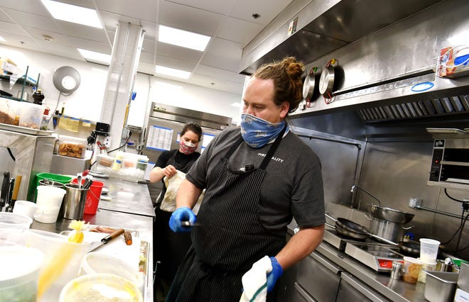 Christopher Bates works in the kitchen of The Quincy Exchange in Corning, one of several restaurants Bates and his wife, Isabel Bogadtke, own throughout the Finger Lakes region, including FLX Wienery in Lakemont. April 1, 2021.
