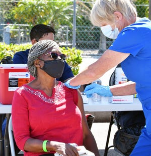 Roselyn Elmondo, 70, of Palm Bay, receives a COVID-19 vaccine earlier this month near Lipscomb Park Community Center in Melbourne.