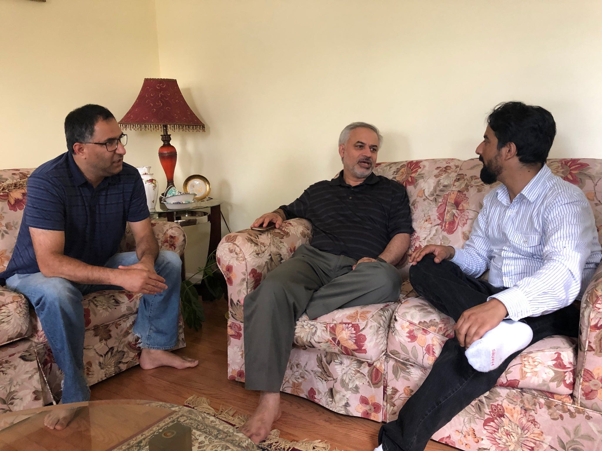 Tahir Qazi (middle) chats with friends, Arif Jan (left) and Shuaib Nabi (right) during Ramadan 2019 in Cherry Hill, New Jersey.