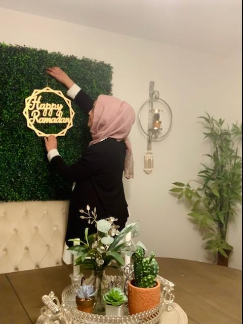 Maryland Director of CAIR Zainab Chaudry puts up decorations at home for Ramadan in Baltimore, Maryland.