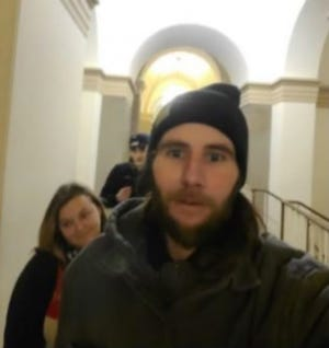Brandon Miller, left, and Stephanie Miller in a photo the FBI says was taken inside the U.S. Capitol on Jan. 6.