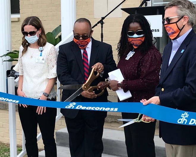Physician assistant Rebekah Basham, the Rev. Adrian Brooks, Dr. Pearl Quartey-Kumapley and Evansville Mayor Lloyd Winnecke open a Deaconess clinic on the campus of Memorial Baptist Church on Monday, April 5, 2021.