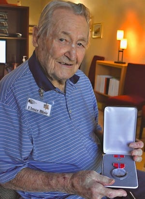"""Elmer Blair, 102, of Fort Myers was awarded the U.S. Army's Bronze Star medal in February. The World War II veteran went 77 years before receiving the award for his """"meritorious"""" combat service against the Germans as an infantry lieutenant in Italy in 1944."""