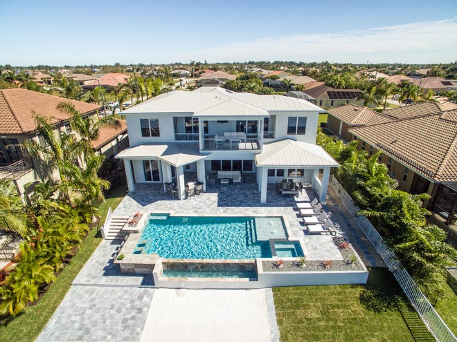 This is the home that Paul Beattie built for Matthias Pommerehne in Cape Coral.  Pommerehne was looking for a modern European style home. Beattie traveled to Germany to look at architecture and innovations there in order to create the perfect home for his client.