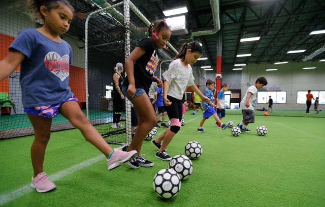 Kids practice ball-control drills at Fair Play Indoor Soccer.