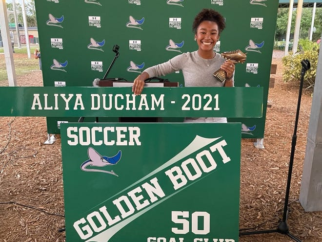 Seacrest senior Aliya Ducham received her school's Golden Boot Award for achieving over 50 goals in her career. Seacrest awards players that score 50 or more goals the golden boot and 25 goals the Silver Boot. Her name will be displayed on the wall in the gym.