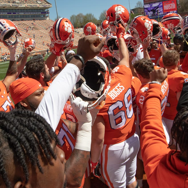 Clemson players huddle before spring game in April. The Tigers are less than 100 days until the season opener against Georgia.