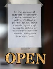 There is a sign at the entrance of St. Elmo Steak House indicating that the restaurant is closed for thorough cleaning on Monday, April 5, 2021 in downtown Indianapolis.  Restaurant has closed as 9 employees have been positive for COVID-19.