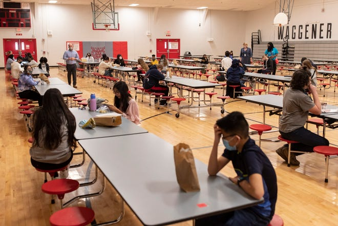 Students eat lunch in the gymnasium as in-person classes resumed at Waggener High School and across JCPS on Monday. April 5, 2021