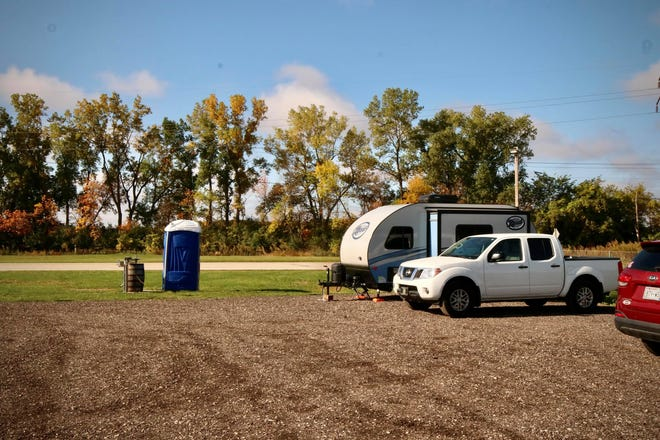 Sarah and Derek Balke's travel trailer is parked in Bare Bones Brewery's parking lot in October 2020. Campers who are members of Harvest Hosts can camp in the brewery's parking lot for free.