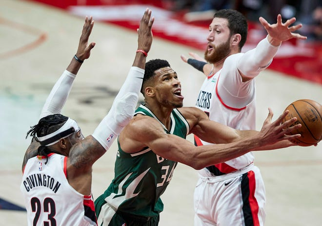 Bucks forward Giannis Antetokounmpo scored  47 points against the Trail Blazers on Friday but sat out the next night against the Kings to rest his ailing left knee.