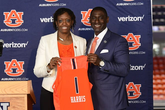 Auburn women's basketball coach Johnnie Harris (left) and athletics director Allen Greene (right) at an introductory press conference Monday, April 5.